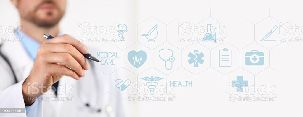 Doctor with a pen pointing medical icons on touchscreen stock photo