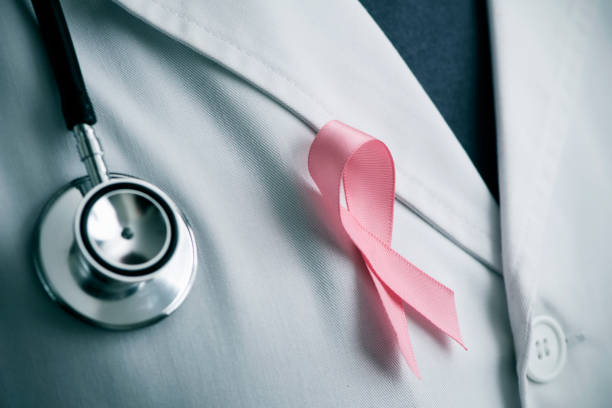 doctor with a pink ribbon - breast cancer awareness ribbon stock pictures, royalty-free photos & images