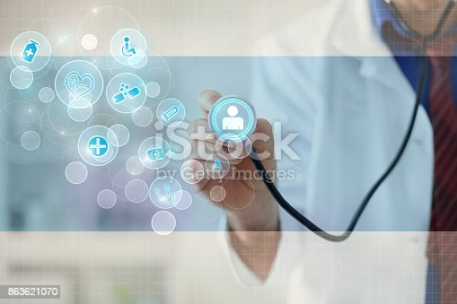 istock Doctor with a stethoscope in the hands and graphical design 863621070
