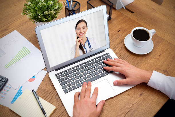 Doctor with a stethoscope on the laptop screen stock photo