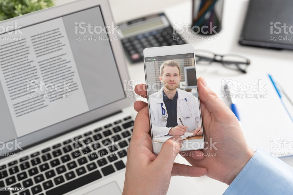 Doctor with a stethoscope. Telehealth conference. stock photo