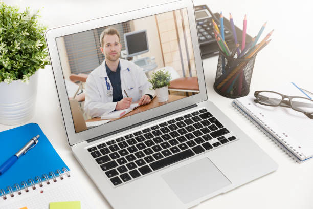 Doctor with a stethoscope. Telehealth conference. – zdjęcie
