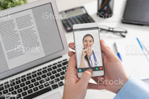 Doctor With A Stethoscope Telehealth Conference Stock Photo - Download Image Now