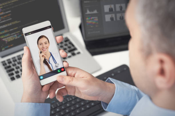 doctor with a stethoscope. telehealth conference. - telemedicine stock pictures, royalty-free photos & images