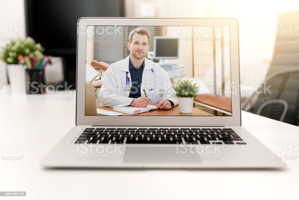 Doctor with a stethoscope. Telemedicine concept stock photo