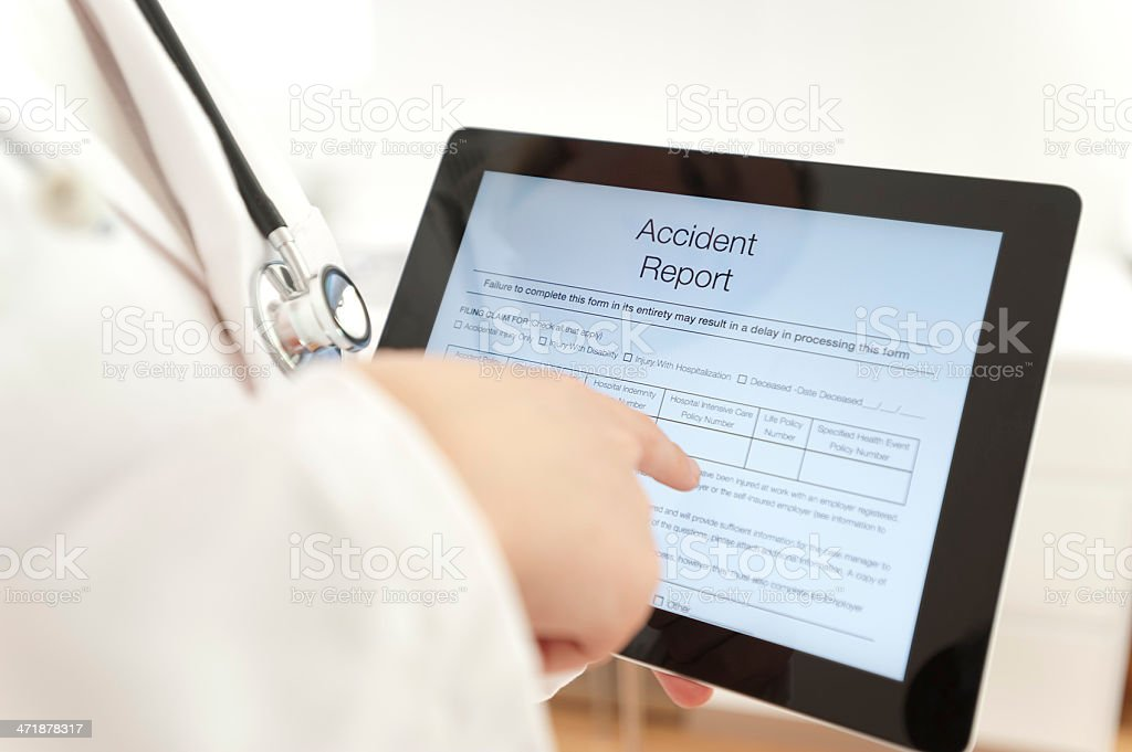 Doctor with Accident report form royalty-free stock photo