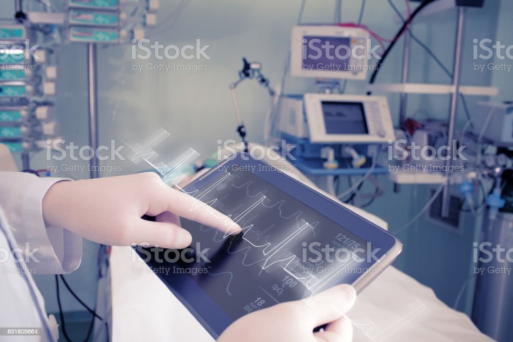 Doctor with advanced equipment in hospital ward stock photo