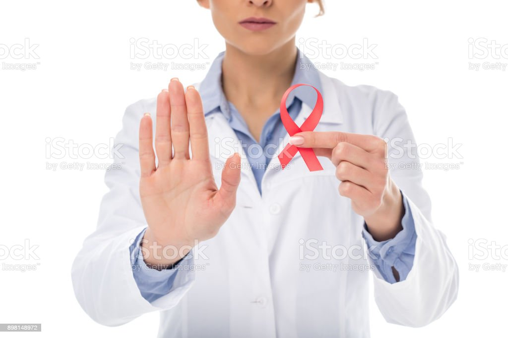 doctor with aids ribbon showing stop stock photo