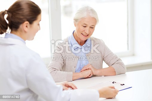 istock doctor with clipboard and senior woman at hospital 695914740