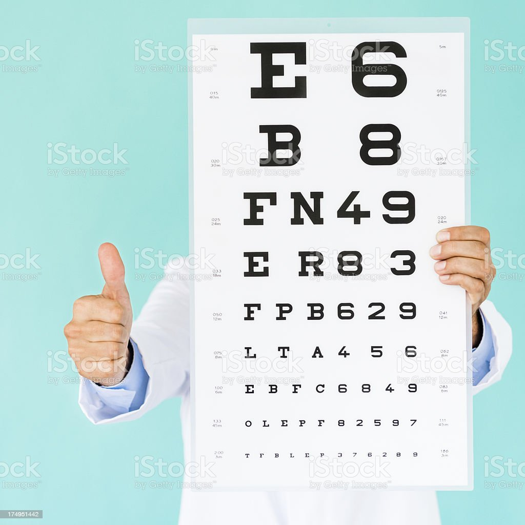 Doctor With Eye Test Chart And Thumbs Up Stock Photo More Pictures
