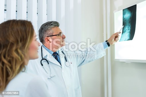 istock Doctor with female patient 614962984