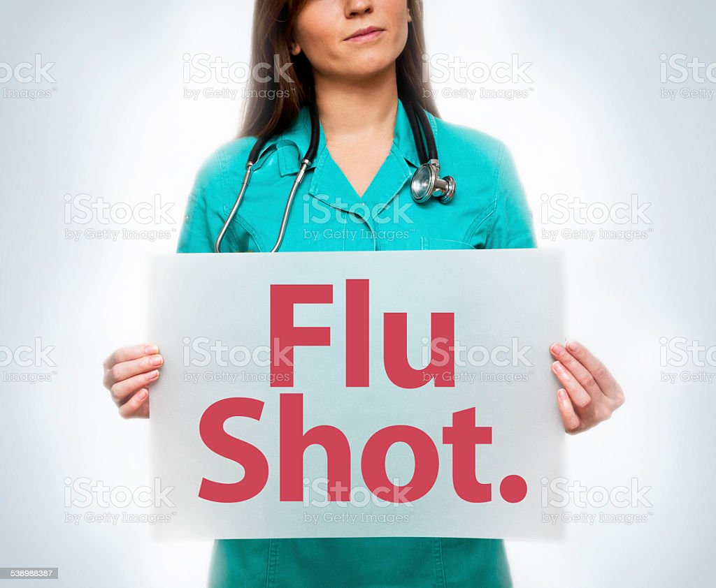 Doctor with Flu Shot sign (Click for more) - Royalty-free 2015 Stock Photo