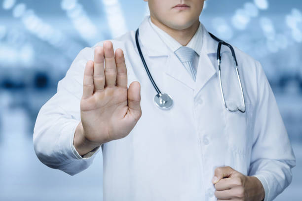 Doctor with forbidden gesture of the hand . stock photo