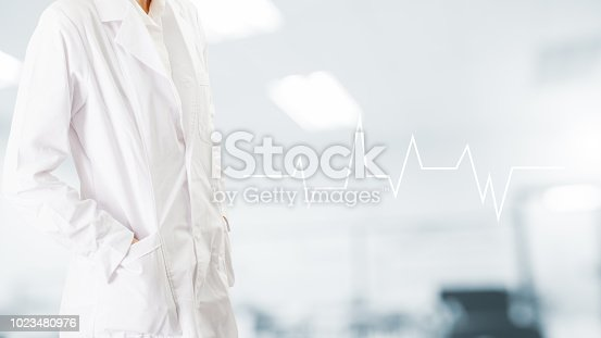 927897070istockphoto Doctor with icon electrocardiogram on hospital background. medical patient concept 1023480976