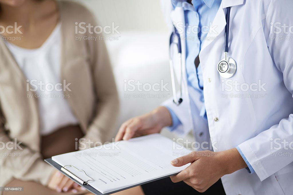Doctor with medical card stock photo