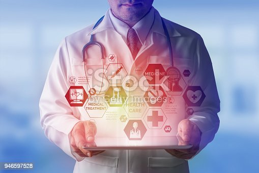 927814202istockphoto Doctor with Medical Healthcare Icon Interface 946597528