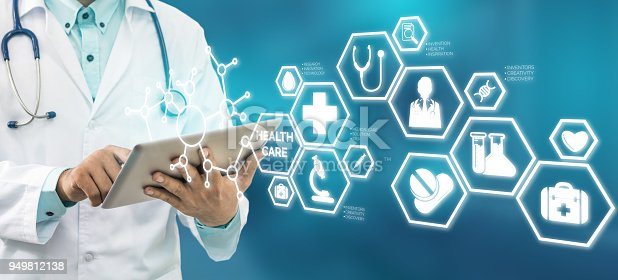 istock Doctor with Medical Healthcare Icon Interface 949812138