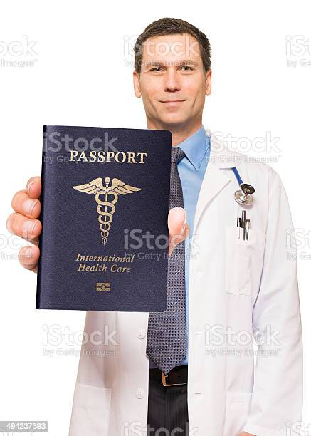 Doctor with medical tourism passport isolated on white background picture id494237393?b=1&k=6&m=494237393&s=612x612&h=ftfx8b5aybbksfqjkpuahdbxdhu04gcu8hwfurdngye=