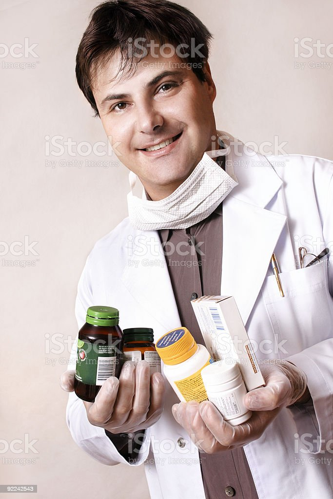 Doctor with medicines and supplements royalty-free stock photo