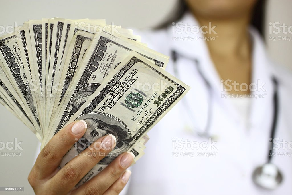 Doctor with money royalty-free stock photo