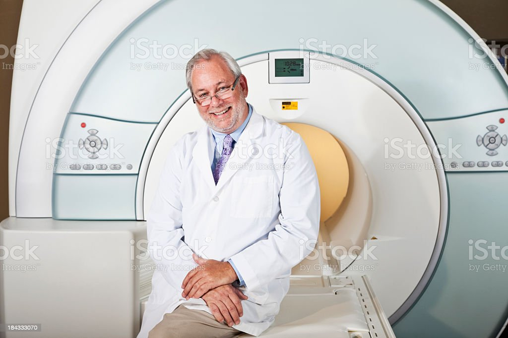 Doctor with MRI scanner stock photo