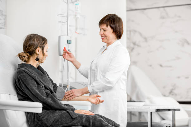 Doctor with patient during the blood purification procedure stock photo