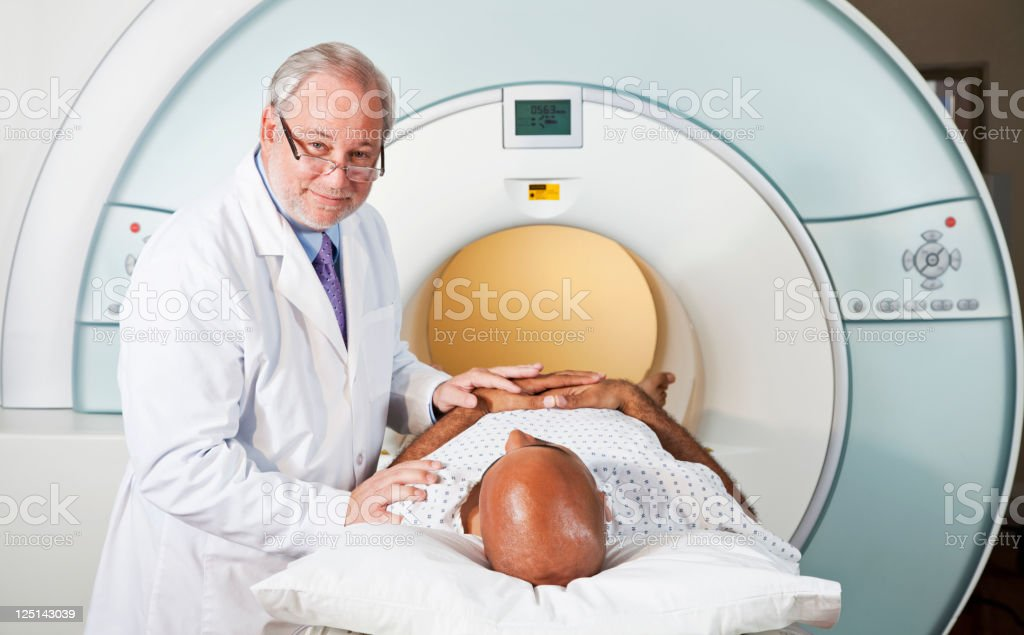Doctor with patient getting MRI scan stock photo