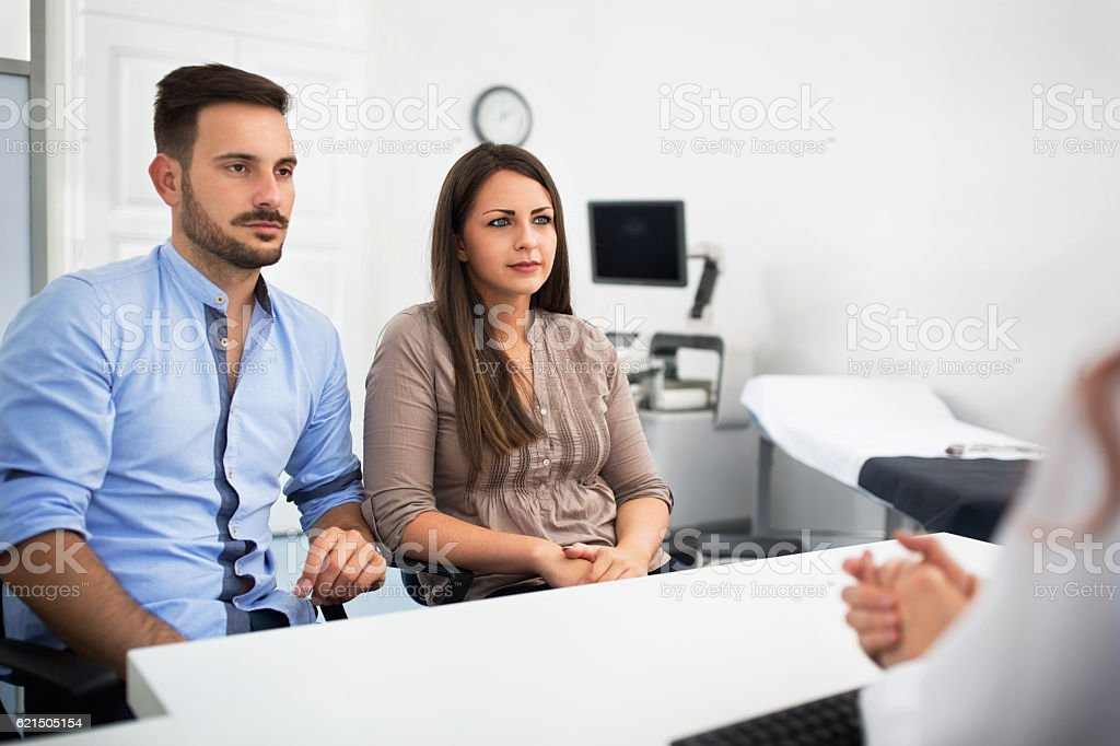 Doctor with patients at clinic stock photo