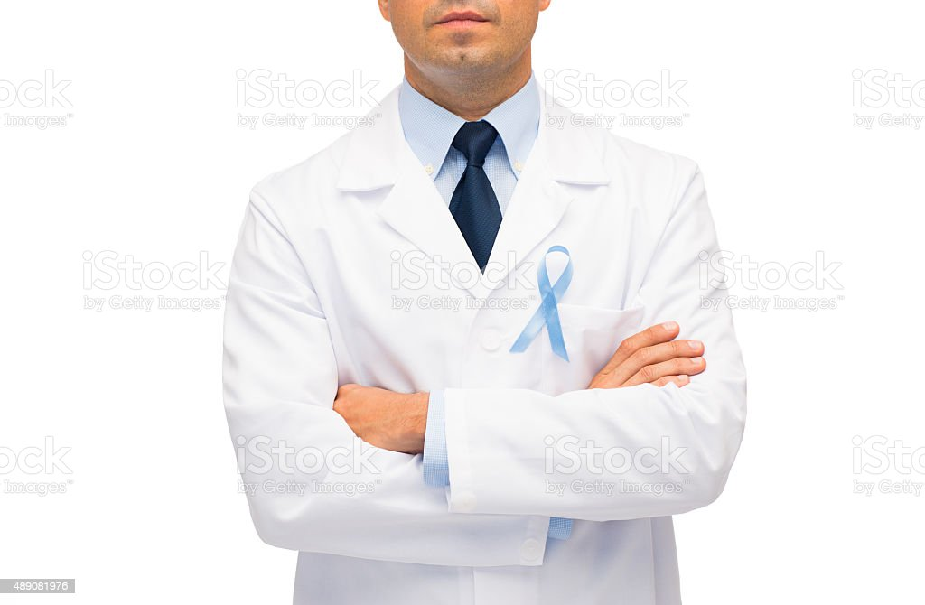 doctor with prostate cancer awareness ribbon stock photo