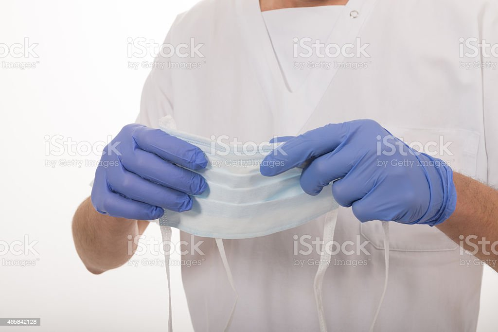 Medico con mascherina protettiva stock photo