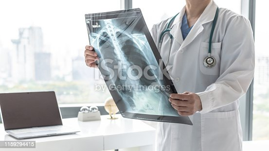 836113342istockphoto Doctor with radiological chest x-ray film for medical diagnosis on patient's health on asthma, lung disease and bone cancer illness, healthcare hospital service concept 1159294415
