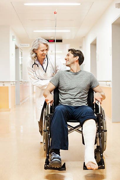 doctor with recovering patient - broken leg stock photos and pictures