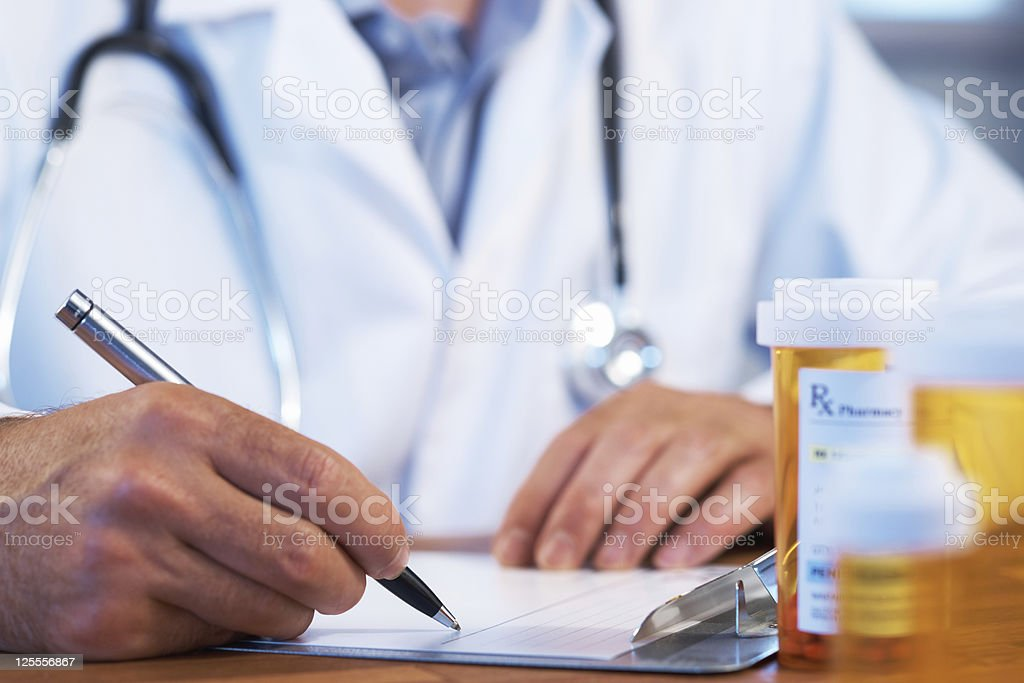 Doctor with RX prescription drug stock photo