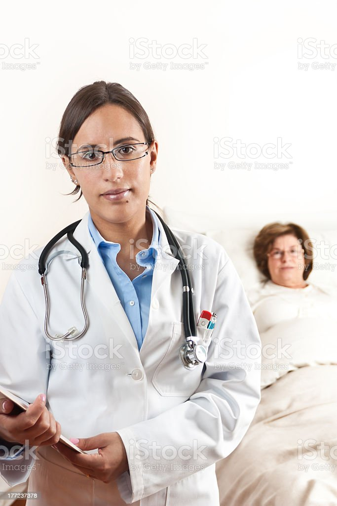 Doctor with senior patient in Background royalty-free stock photo