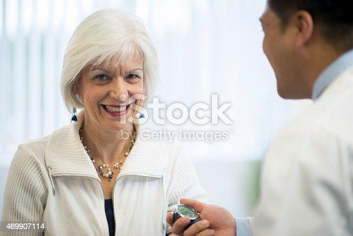 522625266 istock photo Doctor with Senior Patient 469907114