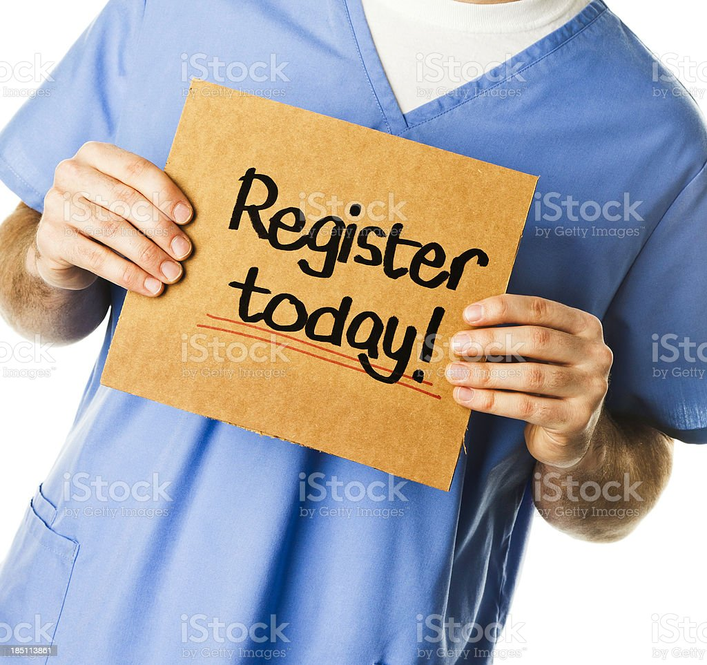 Doctor with Sign: Register Today! stock photo