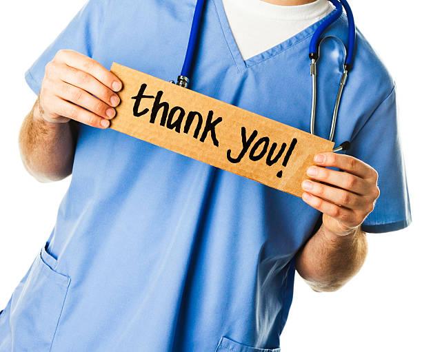 médecin avec un panneau: merci! - admiration photos et images de collection