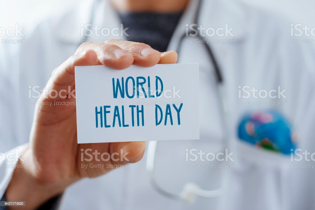 doctor with signboard with text world health day stock photo