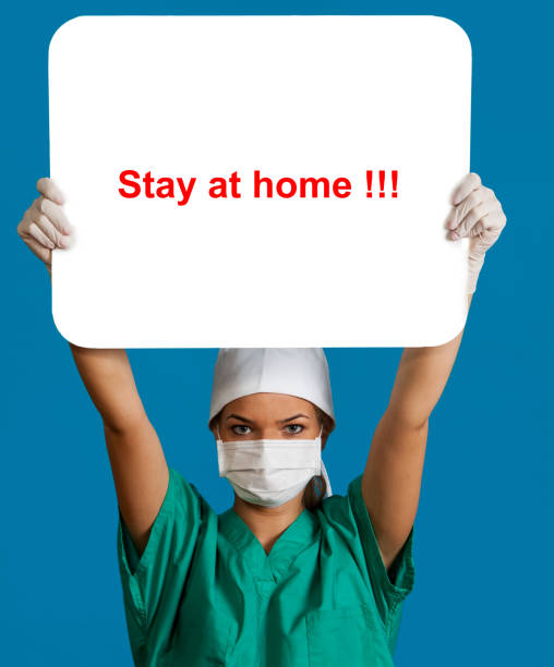 Doctor with Stay at Home Message stock photo