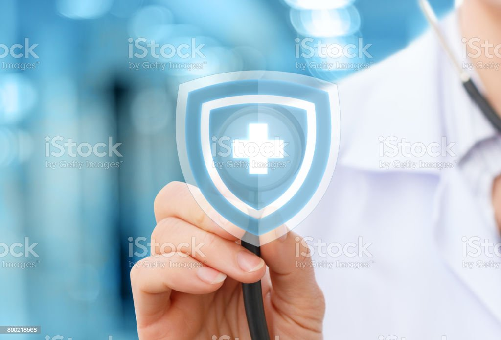 Doctor with stethoscope as the protection of health stock photo