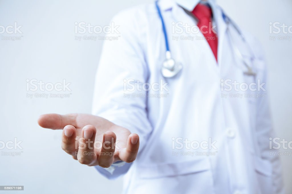 Doctor with stethoscope offering helping hands gesture stock photo