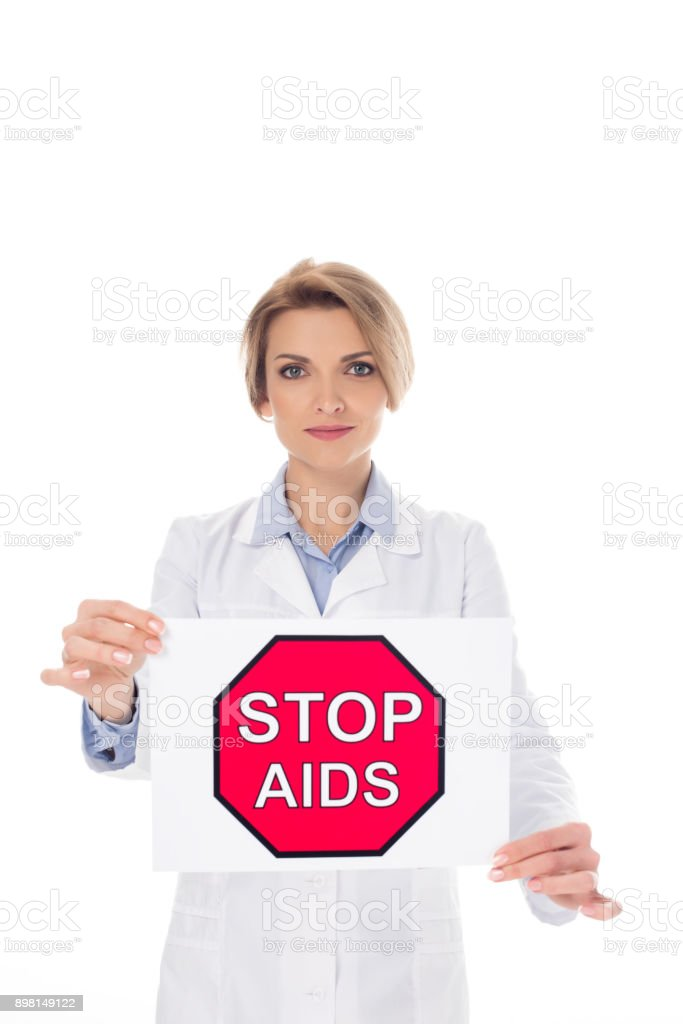 doctor with stop aids placard stock photo