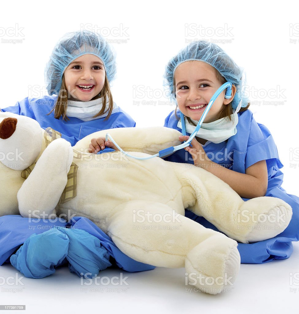 doctor with surgery uniform and toy patient royalty-free stock photo