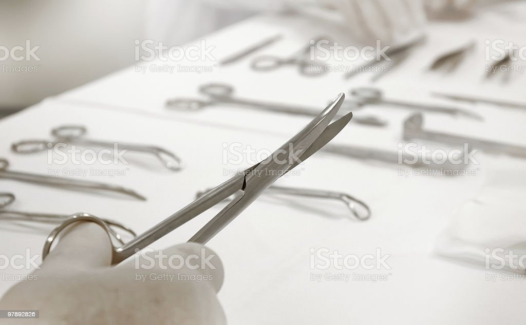 Doctor with surgical scissors royalty-free stock photo
