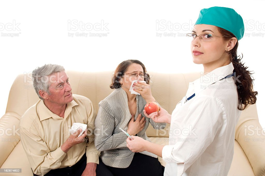 Doctor with syringe and apple concept royalty-free stock photo