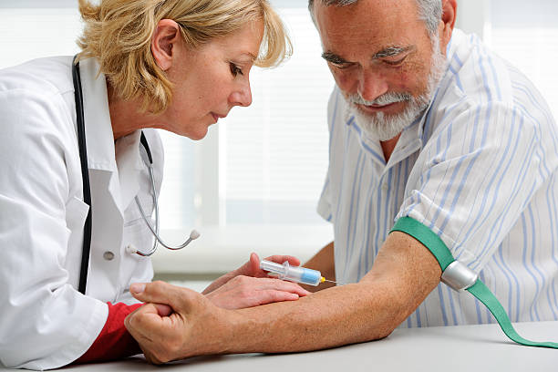 doctor with syringe is taking blood for test stock photo