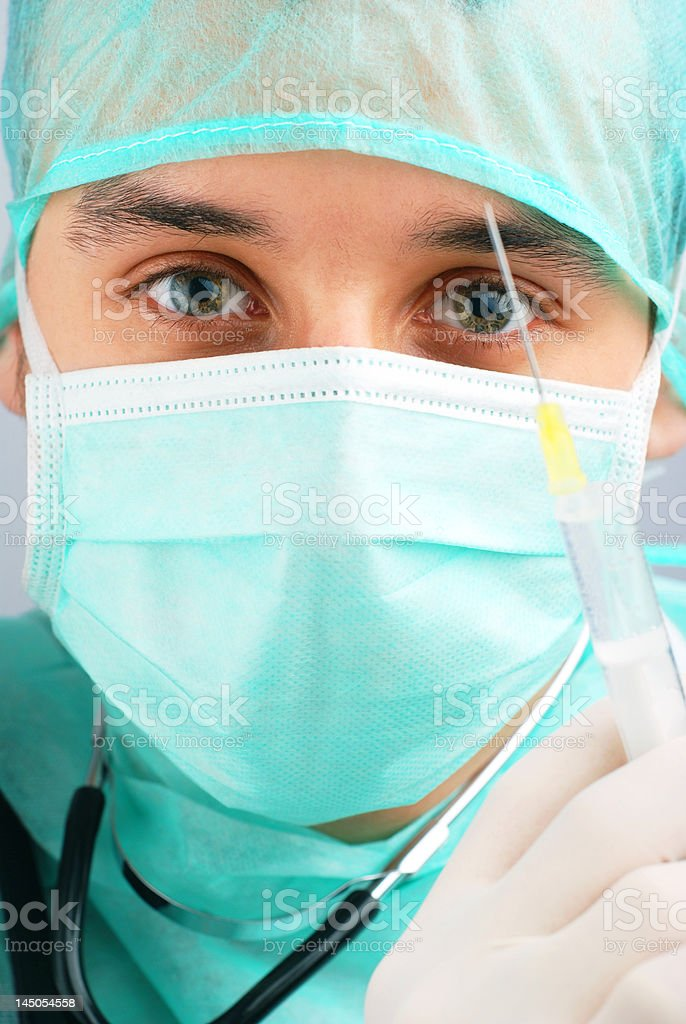 Doctor with syringe royalty-free stock photo