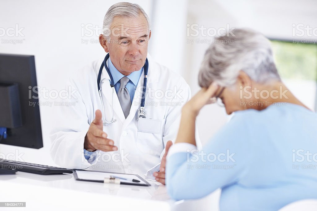Doctor with unhappy patient royalty-free stock photo