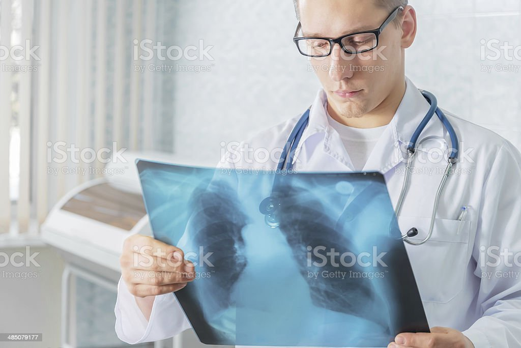 Doctor with x-ray picture stock photo