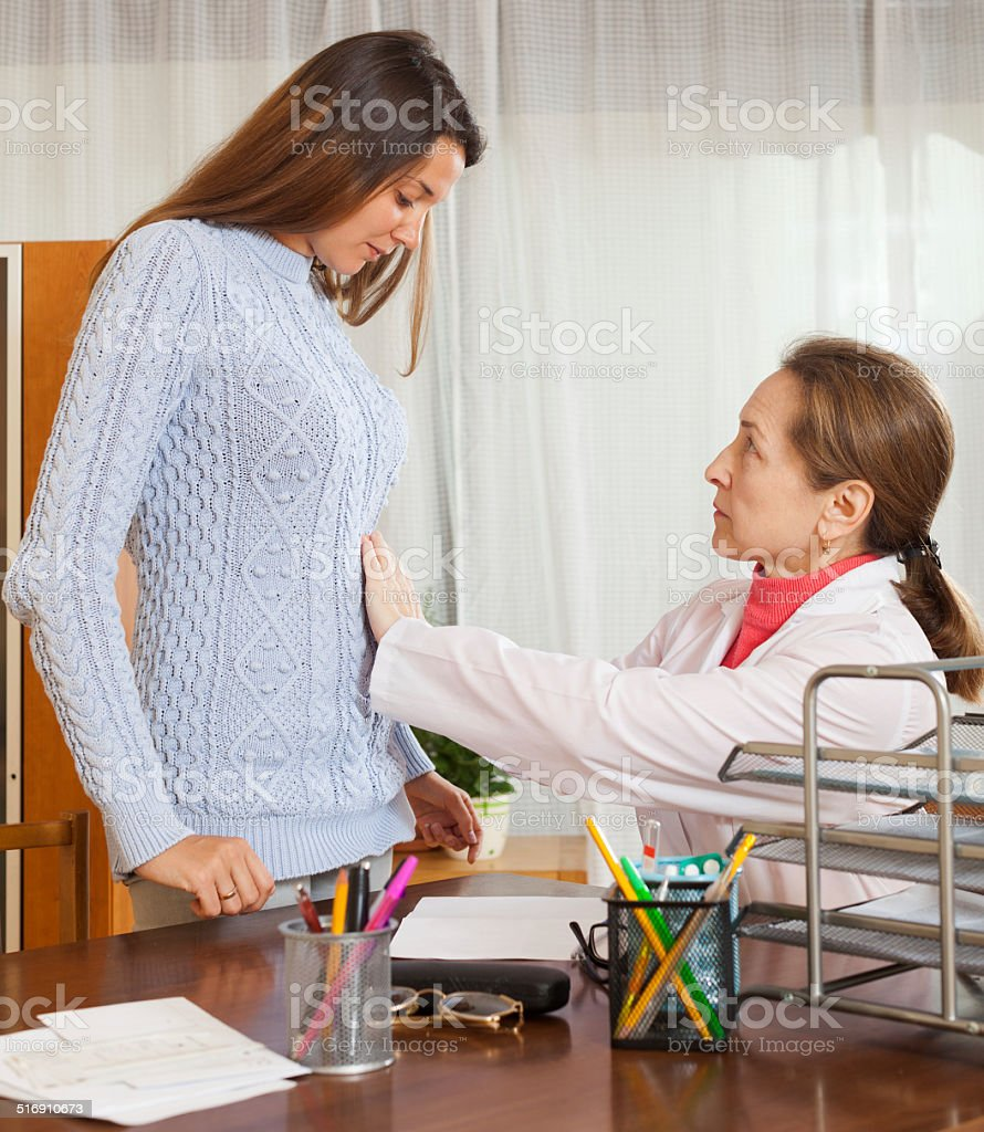 Doctor with young female patient stock photo
